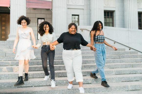 Smiling teenagers descending steps together